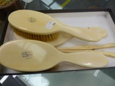 A GROUP OF IVORY BACKED DRESSING TABLE BRUSHES, A MIRROR AND GLOVE STRETCHER.