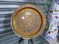 AN EASTERN BRASS COPPER AND SILVER INLAID SMALL SHALLOW TRAY.