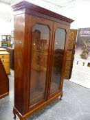 A LARGE EARLY 20th C. MAHOGANY GLAZED TWO DOOR BOOKCASE, WITH ADJUSTABLE SHELVES. W 134 X D 38 X H
