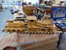 AN APPARENTLY SCRATCH BUILT MODEL LOCOMOTIVE TOGETHER WITH TENDER AND TRACK.