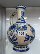 A DELFT BLUE AND WHITE EWER.