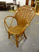 A WOVEN SPLIT WALNUT AND RUSTIC BENTWOOD ELBOW CHAIR, THE HOOP BACK AND CIRCULAR SEAT OF WOVEN