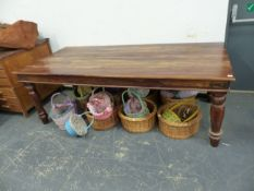 A LARGE HARDWOOD DINING TABLE ON TURNED SUPPORTS, WITH IRON CORNER MOUNTS TO STRETCHERS. L 220 X W