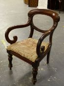 A VICTORIAN MAHOGANY BALLOON BACKED ELBOW CHAIR, THE ARMS WITH SCROLLED FRONTS ABOVE THE DROP IN