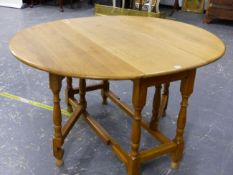 AN OAK COTTAGE GATE LEG SUPPER TABLE THE TOP 134 X 113 X 74 TOGETHER WITH FOUR SIMILAR RUSH SEAT