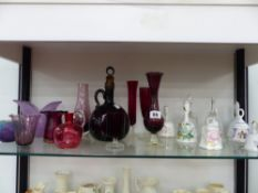 A QUANTITY OF VARIOUS COLOURED GLASSWARES, INCLUDING CRANBERRY, AND ORNAMENTAL TABLE BELLS.
