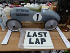 A VINTAGE STYLE CHILDS SCOOT ALONG CAR, AND WOODEN PIT / LAP BOARDS.