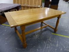 AN 18th C. STYLE PALE OAK REFECTORY DINING TABLE ON TURNED LEGS. L 174 X W 97 X H 76cms.