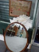 A FRAMED ALPHABET SAMPLER DATED 1876, VARIOUS TABLE LINENS AND A SWING MIRROR.