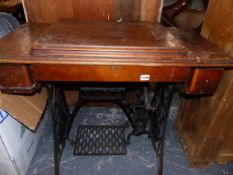 A SINGER TREADLE SEWING MACHINE BASE ONLY.