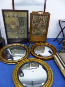 THREE REGENCY STYLE CONVEX WALL MIRRORS, TOGETHER WITH THREE WOOD FRAMED FIRE SCREENS.