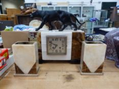 AN ART DECO ONYX AND MARBLE CLOCK GARNITURE, SURMOUNTED WITH SPELTER LEOPARD.