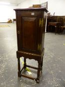 A BESPOKE QUALITY 17th C. STYLE OAK PANEL DOOR CABINET ON TURNED LEG STAND. 40 X28 X 112cms.