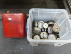 A QUANTITY OF VARIOUS PRESSURE GAUGE DIALS AND A VINTAGE FUEL CAN.
