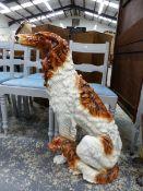 A LARGE POTTERY FIGURE OF A DOG.