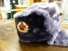 A RUSSIAN FAUX FUR MILITARY TYPE HAT.