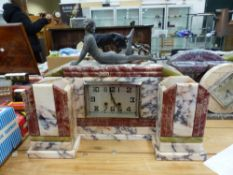 AN ART DECO VARIEGATED MARBLE MANTLE CLOCK GARNITURE SURMOUNTED WITH GIRL IN SWIMSUIT.