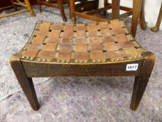A SIMPSON OF KENDAL OAK STOOL WITH INTERWOVEN LEATHER STRAP WORK SEAT. W 40 x D 30.5 x H 25.5cms.