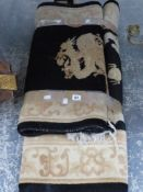 TWO BLACK GROUND CHINESE RUGS.
