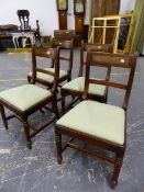 A SET OF FOUR GEORGE IV MAHOGANY DINING CHAIRS WITH REEDED BACK UPRIGHTS AND RAILS, DROP IN SEATS ON