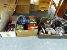 A QUANTITY OF STAINLESS STEEL SAUCEPANS, DECORATIVE KITCHEN TINS, AND A DAB STEREO SYSTEM.