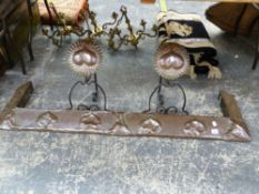 AN ART NOUVEAU COPPER FIRE CURB AND A PAIR OF COPPER AND WROUGHT IRON MATCHING DOGS.