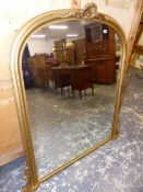 A LARGE VICTORIAN STYE GILT FRAMED ARCH TOP OVER MANTLE MIRROR. W 120 X H 140cms.