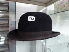 A BOWLER HAT BY DUNN & CO.