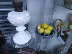 AN ANTIQUE OPAQUE GLASS OIL LAMP, PAIR OF GLASS DISHES AND POTTERY LEMONS.