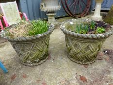 A PAIR OF LATTICE DECORATED GARDEN URNS / PLANTERS.