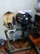 A SUZUKI 4HP OUTBOARD MOTOR AND ONE OTHER.