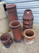 THREE LARGE AND TWO SMALL CHIMNEY POTS.