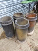 FOUR SIMILAR LARGE CHIMNEY POTS.