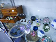 FOURTEEN GLASS PAPERWEIGHTS, A THREE DRAWER COLLECTOR'S CHEST, BADGES, ETC.