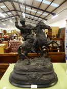 A LARGE SPELTER FIGURE OF A RUSSIAN WARRIOR ON HORSEBACK.