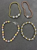 FOUR ASSORTED SILVER BRACELETS WITH YELLOW, AND ROSE GOLD GILT. THREE EXPANDING STACKER BRACELETS