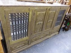 A LARGE INDIAN BRASS DECORATED SIDE CABINET.