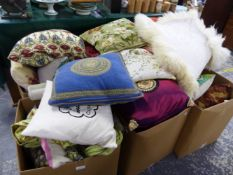 A LARGE COLLECTION OF VARIOUS DECORATIVE CUSHIONS OF DIFFERENT SIZES AND PATTERNS.