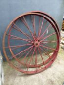 A PAIR OF IRON CART WHEELS.