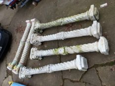 A SET OF SIX LARGE CAST CLASSICAL COLUMNS.