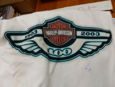 A COLLECTION OF HARLEY-DAVIDSON T SHIRTS AND RELATED BOOKS.