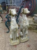 A PAIR OF LARGE SEATED LURCHER GATEPOST FINIALS.