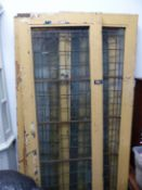 A SET OF FOUR ANTIQUE BRONZE GLAZED ARCHITECTURAL DOORS.