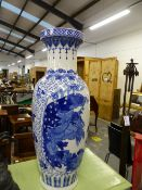 A LARGE ORIENTAL BLUE AND WHITE VASE. H 80CMS.