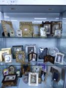 A LARGE QUANTITY OF VINTAGE STYLE PHOTO FRAMES.