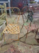 A PAIR OF GARDEN CHAIRS.