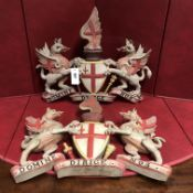 A PAIR OF CARVED AND PAINTED WOOD COATS OF ARMS FOR THE CITY OF LONDON. W 47.5cms.