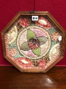 AN OCTAGONAL FRAME OF BARBADIAN COLOURFUL SHELLS ARRANGED AS A VALENTINE, THE FRAME. W 34.5cms.
