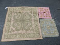 A PINK SILK PANEL WORKED IN SILVER THREAD WITH A QUATREFOIL WITHIN FLORAL BAND. 96 x 89cms. TOGETHER