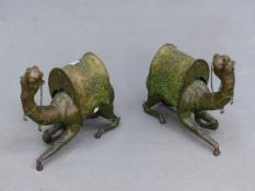 A PAIR OF GREEN DETAILED BRASS CAMELS WEARING FOLIATE SADDLE CLOTHS. H 37cms.